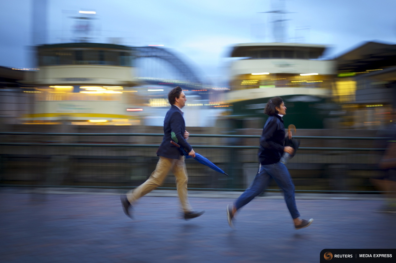 Commuters run to catch a ferry to the Sydney suburb of Manly from Circular Quay, November 3, 2015. Sydney's ferry system has been its lifeblood since the mid 1800s, transporting more than 15 million individual passenger journeys each year, according to the Bureau of Transport Statistics. From fast-food employees to finance industry executives, more than 40,000 trips are taken every day. Picture taken November 3, 2015. REUTERS/Jason Reed