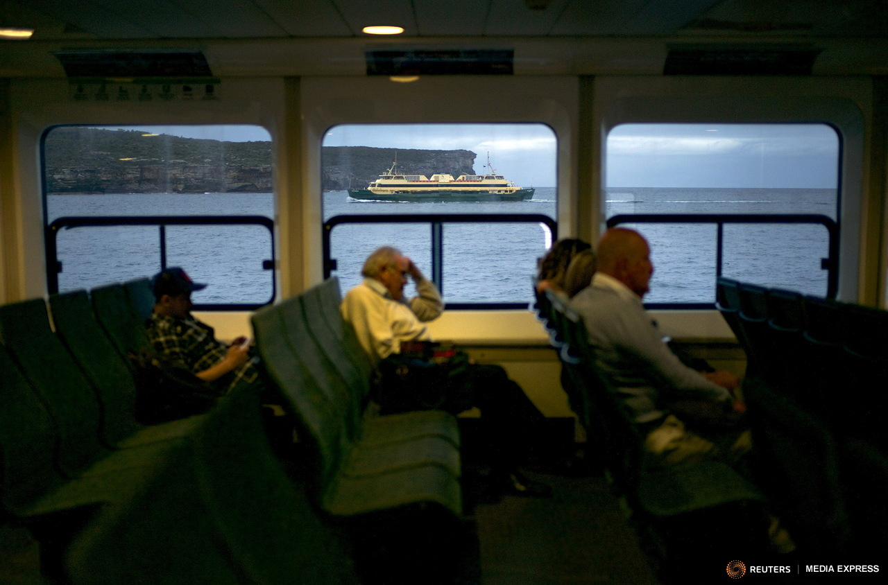 The ferry 'Narrabeen', named after a northern suburbs beach, passes by north head and the Pacific Ocean beyond, the entry to Sydney's harbour on its way to Manly from Circular Quay, November 3, 2015. Sydney's ferry system has been its lifeblood since the mid 1800s, transporting more than 15 million individual passenger journeys each year, according to the Bureau of Transport Statistics. From fast-food employees to finance industry executives, more than 40,000 trips are taken every day. Picture taken November 3, 2015. REUTERS/Jason Reed