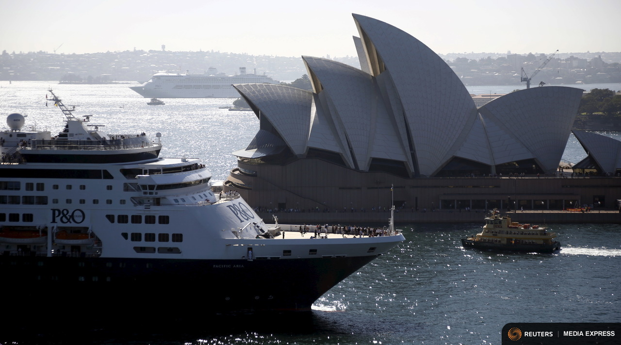 The Sydney ferry Golden Grove (R) moves between the Sydney Opera House and new P&O Cruises ship Pacific Aria in Sydney, Australia, November 25, 2015. Sydney's ferry system has been its lifeblood since the mid 1800s, transporting more than 15 million individual passenger journeys each year, according to the Bureau of Transport Statistics. From fast-food employees to finance industry executives, more than 40,000 trips are taken every day. Picture taken November 25, 2015. REUTERS/Jason Reed