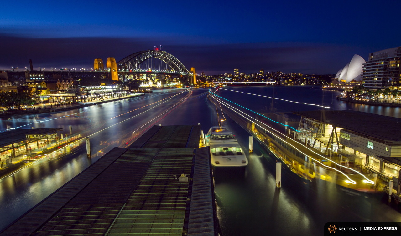 Streaks of light from arriving ferries illuminate wharves at Sydney's Circular Quay terminal in this seven-minute-long time exposure at dusk, July 16, 2015. Sydney's ferry system has been its lifeblood since the mid 1800s, transporting more than 15 million individual passenger journeys each year, according to the Bureau of Transport Statistics. From fast-food employees to finance industry executives, more than 40,000 trips are taken every day. Picture taken July 16, 2015. REUTERS/Jason Reed TPX IMAGES OF THE DAY
