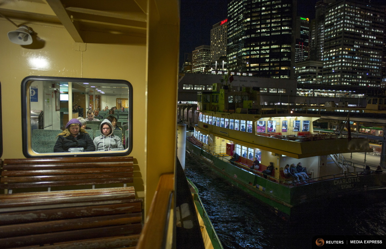 Commuters wait for their ferry to leave Circular Quay wharf en route to Manly as First Fleet class Ferry 'Charlotte' arrives, July 2, 2015. Sydney's ferry system has been its lifeblood since the mid 1800s, transporting more than 15 million individual passenger journeys each year, according to the Bureau of Transport Statistics. From fast-food employees to finance industry executives, more than 40,000 trips are taken every day. Picture taken July 2, 2015. REUTERS/Jason Reed