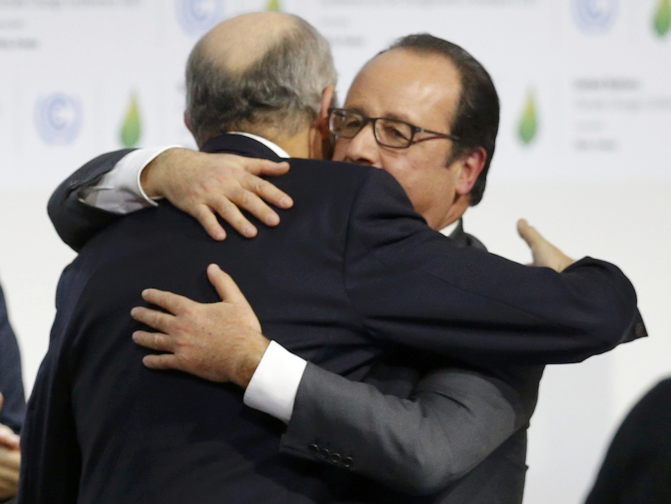 French President Francois Hollande (R) embraces French Foreign Affairs Minister Laurent Fabius, President-designate of COP21 during the Climate Change, at the final plenary session at the World Climate Change Conference 2015 (COP21) at Le Bourget, near Paris, France, December 12, 2015.   REUTERS/Stephane Mahe