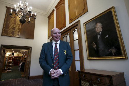 Former club captain Michael Fleming poses by a portrait of Winston Churchill inside the clubhouse of the Wentworth Club in Virginia Water, Britain, January 8, 2016. REUTERS/Peter Nicholls