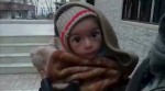 A toddler is held up to the camera in this still image taken from video said to be shot in Madaya on January 5, 2016. Handout via Social Media Website