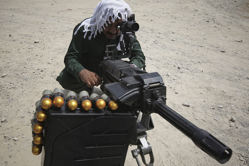 A member of Iran's Revolutionary guard aim with an anti-personnel gun as he takes part in a war game in the Hormuz area of southern Iran April 24, 2010. REUTERS/Mehdi Marizad/Fars News