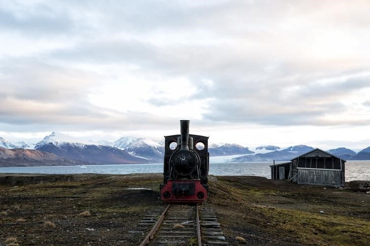 """An old locomotive train that was used for transporting coal is preserved as a monument at Ny-Alesund, in Svalbard, Norway, October 11, 2015. A Norwegian chain of islands just 1,200 km (750 miles) from the North Pole is trying to promote new technologies, tourism and scientific research in a shift from high-polluting coal mining that has been a backbone of the remote economy for decades. Norway suspended most coal mining on the Svalbard archipelago last year because of the high costs, and is looking for alternative jobs for about 2,200 inhabitants on islands where polar bears roam. Part of the answer may be to boost science: in Ny-Alesund, the world's most northerly permanent non-military settlement, scientists from 11 nations including Norway, Germany, France, Britain, India and South Korea study issues such as climate change. The presence of Norway, a NATO member, also gives the alliance a strategic foothold in the far north, of increasing importance after neighbouring Russia annexed Ukraine's Crimea region in 2014.    REUTERS/Anna FilipovaPICTURE 14 OF 19 - SEARCH """"SVALBARD FILIPOVA"""" FOR ALL IMAGES"""