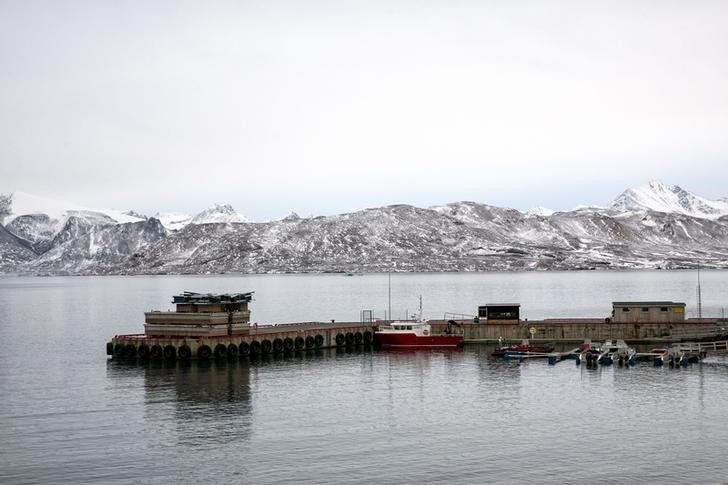 "Dinghies and research vessels are pictured in the small harbour near Ny-Alesund on Spitsbergen, Norway October 15, 2015. A Norwegian chain of islands just 1,200 km (750 miles) from the North Pole is trying to promote new technologies, tourism and scientific research in a shift from high-polluting coal mining that has been a backbone of the remote economy for decades. Norway suspended most coal mining on the Svalbard archipelago last year because of the high costs, and is looking for alternative jobs for about 2,200 inhabitants on islands where polar bears roam. Part of the answer may be to boost science: in Ny-Alesund, the world's most northerly permanent non-military settlement, scientists from 11 nations including Norway, Germany, France, Britain, India and South Korea study issues such as climate change. The presence of Norway, a NATO member, also gives the alliance a strategic foothold in the far north, of increasing importance after neighbouring Russia annexed Ukraine's Crimea region in 2014.    REUTERS/Anna FilipovaPICTURE 16 OF 19 - SEARCH ""SVALBARD FILIPOVA"" FOR ALL IMAGES"