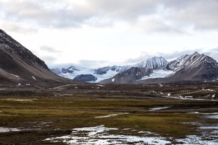 "Snow covers Broggerdalen mountain near Ny-Alesund, Svalbard, Norway October 11, 2015. A Norwegian chain of islands just 1,200 km (750 miles) from the North Pole is trying to promote new technologies, tourism and scientific research in a shift from high-polluting coal mining that has been a backbone of the remote economy for decades. Norway suspended most coal mining on the Svalbard archipelago last year because of the high costs, and is looking for alternative jobs for about 2,200 inhabitants on islands where polar bears roam. Part of the answer may be to boost science: in Ny-Alesund, the world's most northerly permanent non-military settlement, scientists from 11 nations including Norway, Germany, France, Britain, India and South Korea study issues such as climate change. The presence of Norway, a NATO member, also gives the alliance a strategic foothold in the far north, of increasing importance after neighbouring Russia annexed Ukraine's Crimea region in 2014.    REUTERS/Anna FilipovaPICTURE 18 OF 19 - SEARCH ""SVALBARD FILIPOVA"" FOR ALL IMAGES"