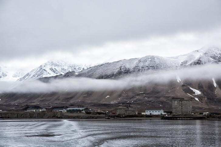 """Low clouds are seen in the Kings Bay of Ny-Alesund, Svalbard, Norway, October 12, 2015. A Norwegian chain of islands just 1,200 km (750 miles) from the North Pole is trying to promote new technologies, tourism and scientific research in a shift from high-polluting coal mining that has been a backbone of the remote economy for decades. Norway suspended most coal mining on the Svalbard archipelago last year because of the high costs, and is looking for alternative jobs for about 2,200 inhabitants on islands where polar bears roam. Part of the answer may be to boost science: in Ny-Alesund, the world's most northerly permanent non-military settlement, scientists from 11 nations including Norway, Germany, France, Britain, India and South Korea study issues such as climate change. The presence of Norway, a NATO member, also gives the alliance a strategic foothold in the far north, of increasing importance after neighbouring Russia annexed Ukraine's Crimea region in 2014.    REUTERS/Anna FilipovaPICTURE 19 OF 19 - SEARCH """"SVALBARD FILIPOVA"""" FOR ALL IMAGES"""