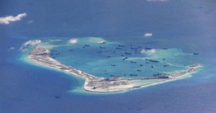Chinese dredging vessels in the waters around Mischief Reef in the disputed Spratly Islands in the South China Sea. U.S. Navy photo, Public Domain