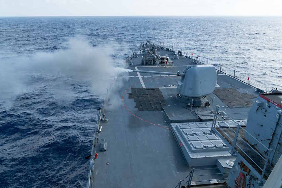 SOUTH CHINA SEA (Jan. 15, 2016)  The Arleigh Burke-class guided-missile destroyer USS Curtis Wilbur (DDG 54) conducts a live fire gunnery exercise with its 5-inch .54-caliber gun. Curtis Wilbur is on patrol in the 7th Fleet area of operations in support of security and stability in the Indo-Asia-Pacific. (U.S. Navy photo by Lt.j.g. Jonathan Peterson, Public Domaine