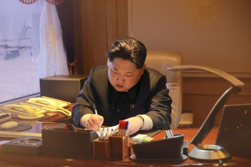North Korean leader Kim Jong Un signs a document regarding a long range rocket launch in this undated photo released by North Korea's Korean Central News Agency (KCNA) in Pyongyang February 7, 2016. REUTERS/KCNA