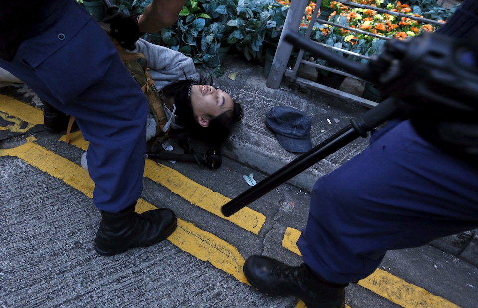 Riot police arrests a protester after a clash at Mongkok district in Hong Kong, China February 9, 2016.      REUTERS/Bobby Yip