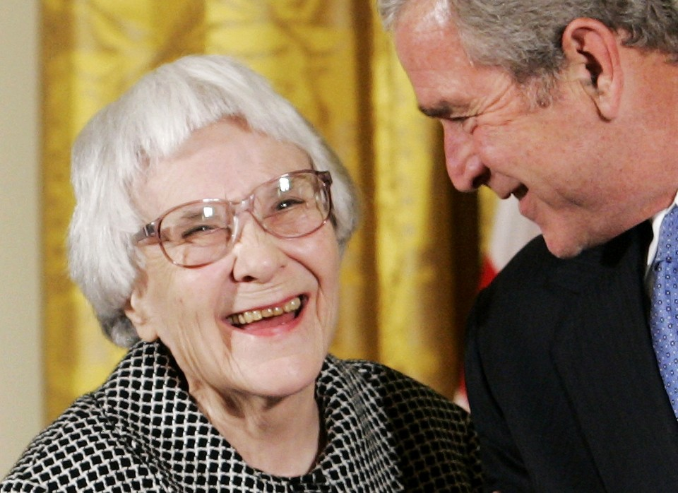 U.S. President George W. Bush (R) before awarding the Presidential Medal of Freedom to American novelist Harper Lee (L) in the East Room of the White House, in this November 5, 2007, file photo. REUTERS/Larry Downing/Files