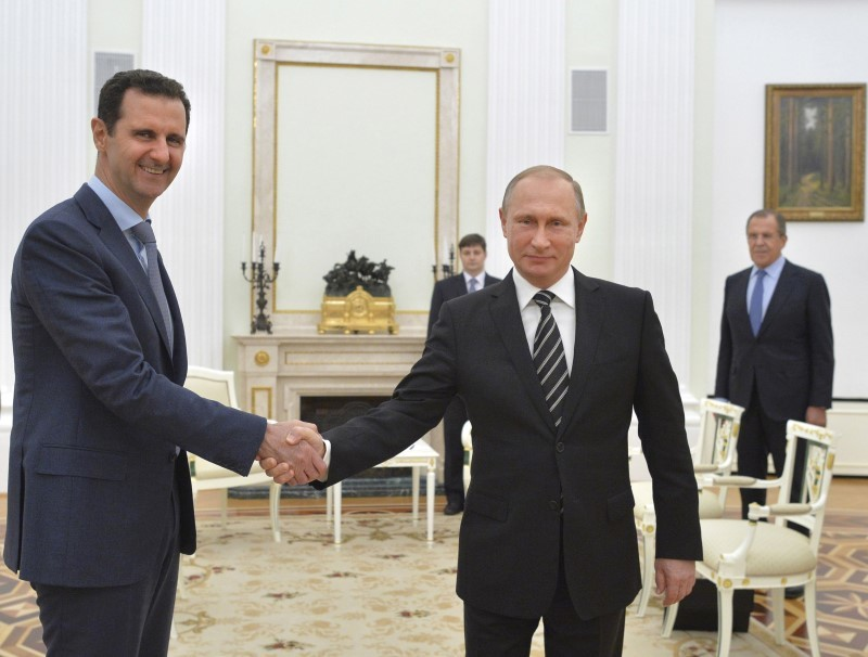 Russian President Vladimir Putin (R) shakes hands with Syrian President Bashar al-Assad during a meeting at the Kremlin in Moscow, Russia, in this October 20, 2015 file photo. REUTERS/Alexei Druzhinin/RIA Novosti/Kremlin/ Files