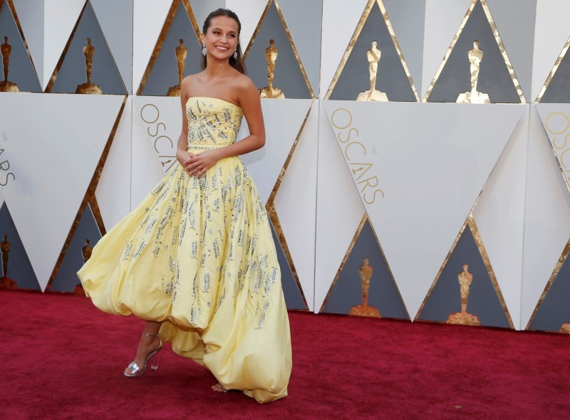 "Alicia Vikander, nominated for Best Supporting Actress in ""Danish Girl,"" wears a yellow Louis Vuitton gown as she arrives at the 88th Academy Awards in Hollywood, California February 28, 2016. REUTERS/Lucy Nicholson"