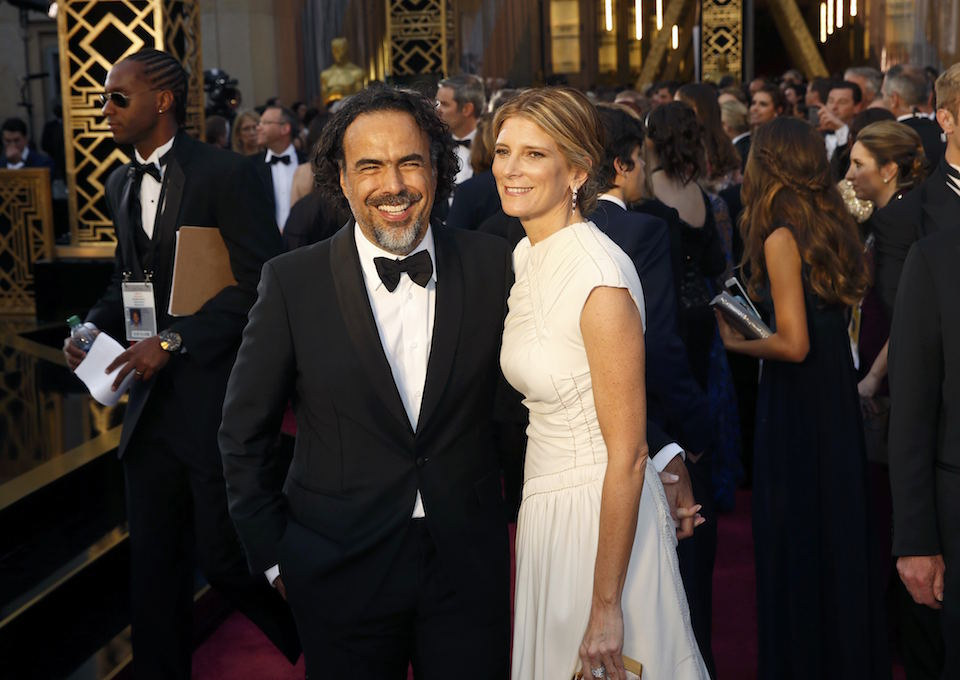 "Alejandro G. Inarritu, nominated for Best Director for his film ""The Revenant"", arrives with his wife Maria Eladia Hagerman at the 88th Academy Awards in Hollywood, California February 28, 2016. REUTERS/Lucas Jackson"