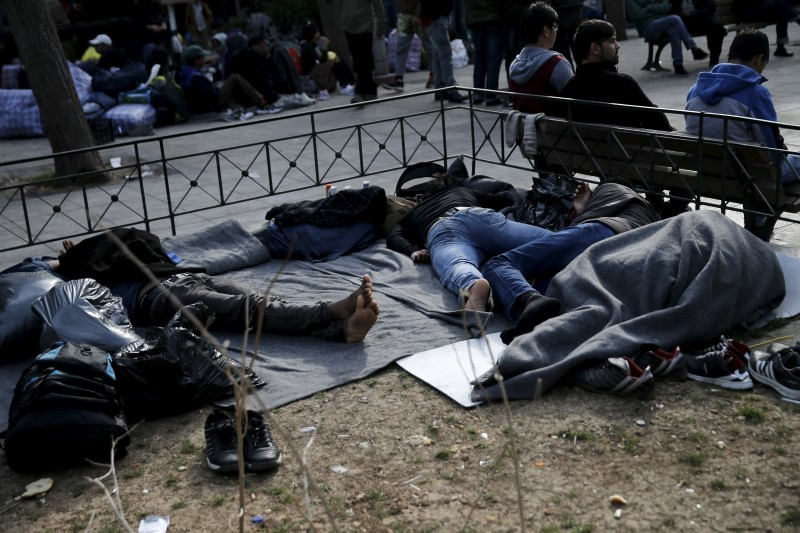 Migrants sleep on Victoria Square, where stranded refugees and migrants, most of them Afghans, find shelter in Athens, Greece, March 3, 2016. REUTERS/Alkis Konstantinidis