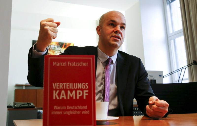 "Marcel Fratzscher, president of the German Institute for Economic Research (DIW), introduces his new book ""The Distribution Battle - Why Inequality in Germany is Rising"" as he speaks during an interview with Reuters in his office in Berlin, Germany, March 7, 2016. REUTERS/Fabrizio Bensch"