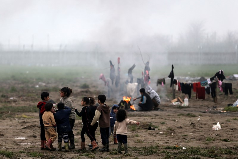 Refugee children play at a makeshift camp for refugees and migrants at the Greek-Macedonian border near the village of Idomeni, Greece, March 18, 2016. REUTERS/Alkis Konstantinidis