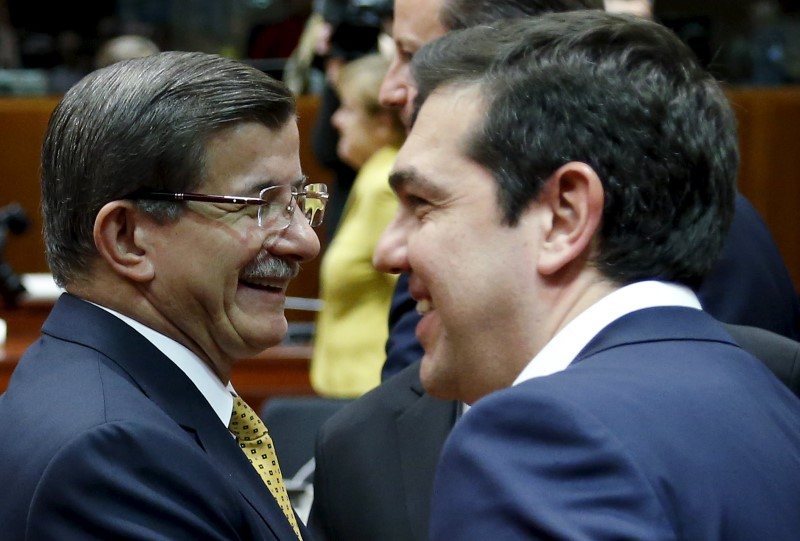Turkish Prime Minister Ahmet Davutoglu and Greek counterpart Alexis Tsipras (R) attend a European Union leaders summit on migration in Brussels, Belgium, March 18, 2016. REUTERS/Francois Lenoir
