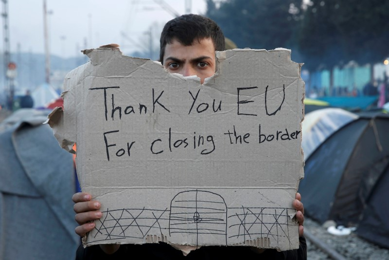 "A refguee holds a message, ""Thank you EU for closing the border"" during a protest asking for the opening of borders at a makeshift camp at the Greek-Macedonian border near the village of Idomeni, Greece, March 18, 2016.   REUTERS/Alkis Konstantinidis"