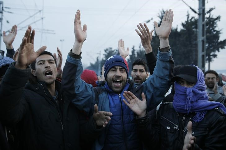Migrants chant during a protest asking for the opening of borders at a makeshift camp at the Greek-Macedonian border near the village of Idomeni, Greece, March 18, 2016. REUTERS/Alkis Konstantinidis