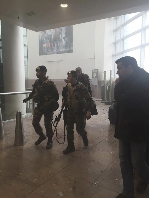 Belgian soldiers secure the area at the scene of explosions at Zaventem airport near Brussels, Belgium, March 22, 2016. REUTERS/Ketevan Kardava/Courtesy of 1tv.ge/Handout via Reuters