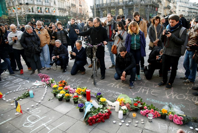 People gather around a memorial in Brussels following bomb attacks s in Brussels, Belgium, March 22, 2016. REUTERS/Charles Platiau