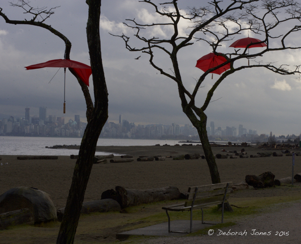 "Vancouver skyline from Spanish Banks beach, with the ""Rainblossom Project"" art installation in foreground. © Deborah Jones 2015"