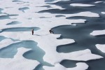 The crew of the U.S. Coast Guard Cutter Healy, in the midst of their ICESCAPE mission, retrieves supplies in the Arctic Ocean in this July 12, 2011 NASA handout photo. Kathryn Hansen/NASA via REUTERS/File Photo