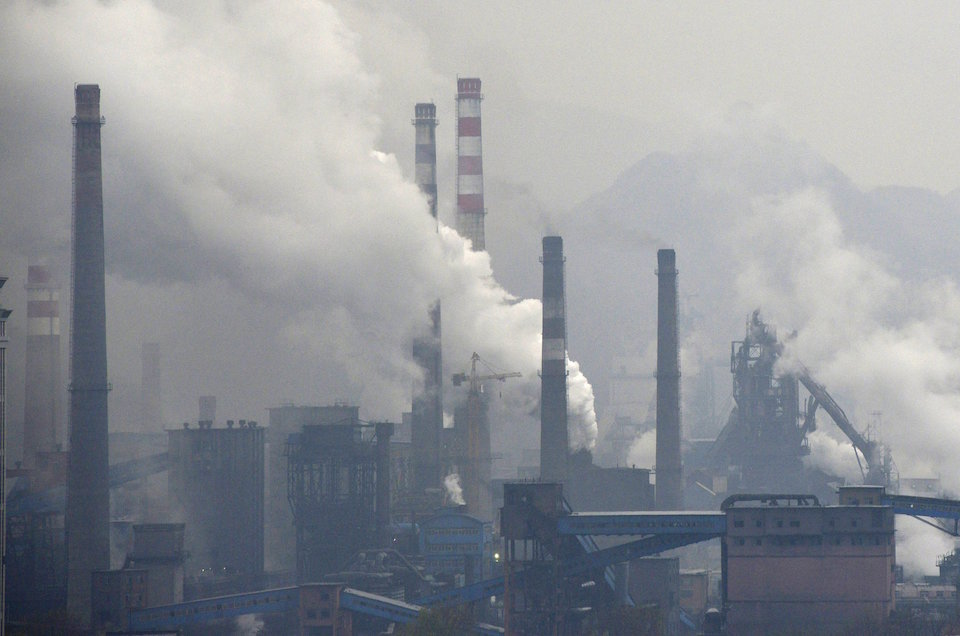 Smoke rises from chimneys and facilities of steel plants in Benxi, Liaoning province November 3, 2013. REUTERS/Stringer/File Photo