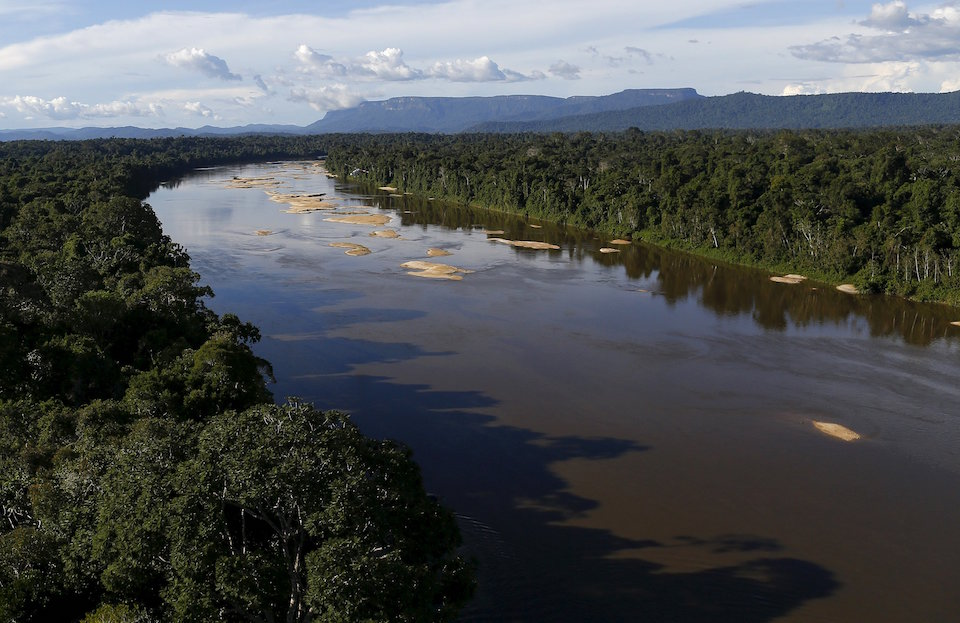 "Uraricoera River is seen during Brazil's environmental agency operation against illegal gold mining on indigenous land, in the heart of the Amazon rainforest, in Roraima state, Brazil April 15, 2016. At over 9.5 million hectares, the Yanomami territory is twice the size of Switzerland and home to around 27,000 indians. The land has legally belonged to the Yanomami since 1992, but illegal miners continue to plague the area, sawing down trees and poisoning rivers with mercury in their lust for gold. REUTERS/Bruno Kelly SEARCH ""AMAZON GOLD"" FOR THIS STORY. SEARCH ""THE WIDER IMAGE"" FOR ALL STORIES"