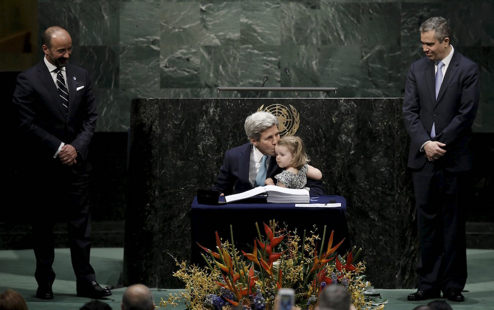 U.S. Secretary of State John Kerry kisses his two-year-old granddaughter Isabelle Dobbs-Higginson after signing the Paris Agreement on climate change at United Nations Headquarters in Manhattan, New York, U.S., April 22, 2016. REUTERS/Mike Segar