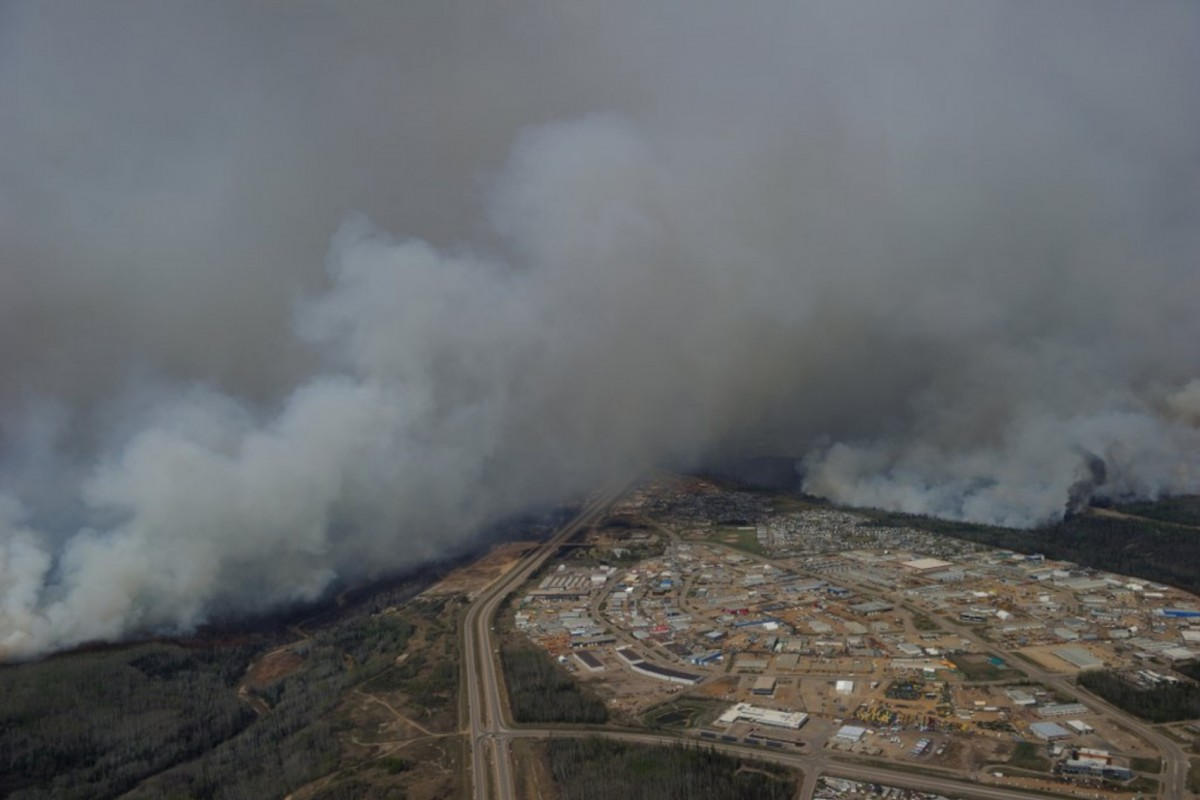 A Canadian Joint Operations Command aerial photo shows wildfires near neighborhoods in Fort McMurray, Alberta, Canada in this image posted on twitter May 5, 2016. Courtesy CF Operations/Handout via REUTERS ATTENTION EDITORS - THIS IMAGE WAS PROVIDED BY A THIRD PARTY. EDITORIAL USE ONLY. NO RESALES. NO ARCHIVE