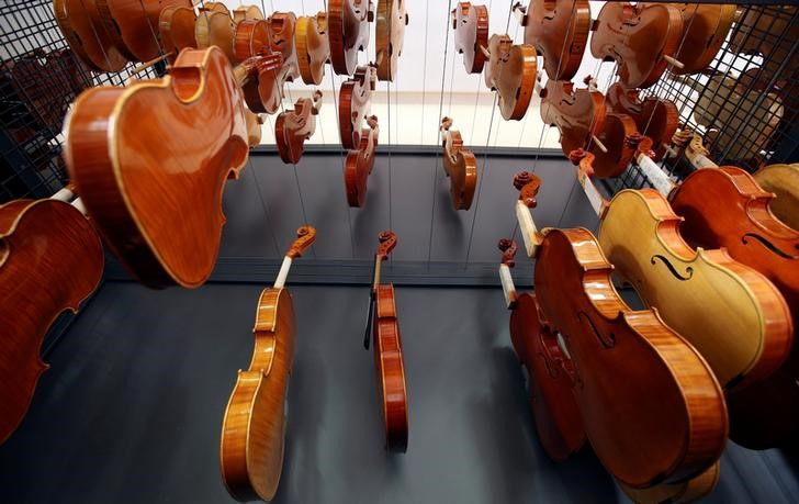 Violins made by students hang to dry at a laboratory of the Antonio Stradivari institute of higher education in Cremona, Italy, April 22, 2016. Making violins is a passion in Cremona, the ancient Italian town that has been producing them since the 16th century, but turning passion into profits has not been easy. Cremona, in northern Italy, has more than 100 workshops making violins and other stringed instruments for musicians worldwide, following in the tradition of its great violin-makers which have included Antonio Stradivari and Nicolo Amati. REUTERS/Stefano Rellandini