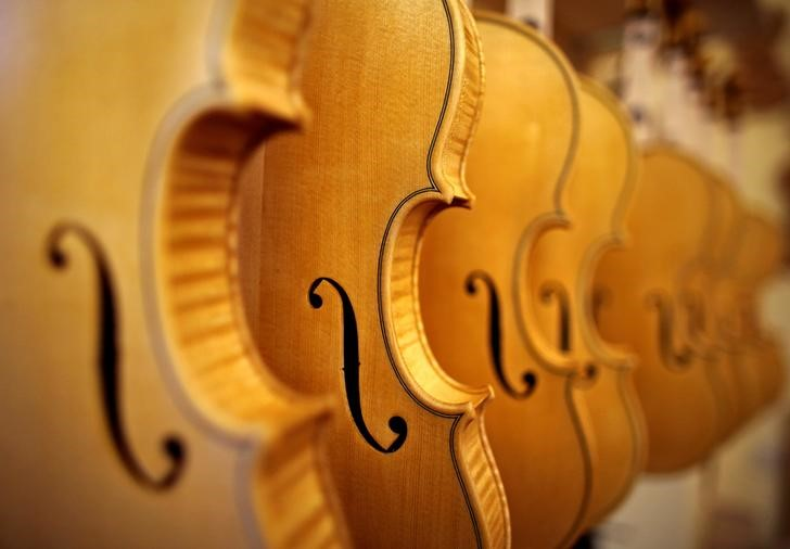 "Violins are seen at Edgar Russ' workshop in Cremona, Italy, March 10, 2016. Making violins is a passion in Cremona, the ancient Italian town that has been producing them since the 16th century, but turning passion into profits has not been easy. Cremona, in northern Italy, has more than 100 workshops making violins and other stringed instruments for musicians worldwide, following in the tradition of its great violin-makers which have included Antonio Stradivari and Nicolo Amati. REUTERS/Stefano Rellandini SEARCH ""VIOLINS CREMONA"" FOR THIS STORY. SEARCH ""THE WIDER IMAGE"" FOR ALL STORIES"