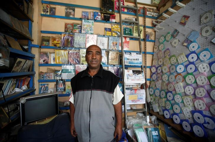 "Muslih Ali Qaid, 59, a bookstore owner, poses for a photograph in Sanaa, Yemen, April 29, 2016. ""My message to the negotiators in Kuwait is: 'Don't give up the rights of the people who stood fast for a whole year, because there are deaths and injuries and complete destruction of the infrastructure.'"" Qaid said. ""I hope that the dialogue will succeed in rebuilding Yemen, there is no hope otherwise."" Anxiety reigns in the Yemeni capital Sanaa, where ordinary people await the outcome of almost a month of peace talks they hope can end a devastating war. REUTERS/Mohamed al-Sayaghi"