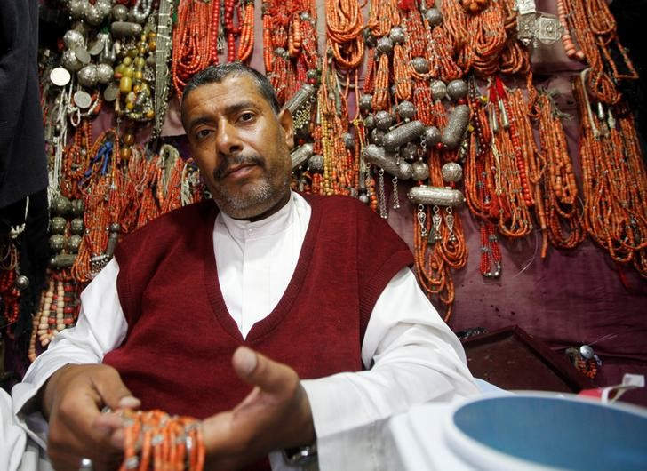 "Abdussalam Hamad al-Harethi, 39 who sells antiques, souvenirs and silverware, poses for a photograph in Sanaa, Yemen, April 21, 2016. ""We are optimistic that we will see the Kuwait negotiations stop the war, especially in light of the decrease in the number of air strikes,"" al-Harethi said. Anxiety reigns in the Yemeni capital Sanaa, where ordinary people await the outcome of almost a month of peace talks they hope can end a devastating war. REUTERS/Mohamed al-Sayaghi"