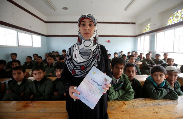 "Wafaa Mansour, a mathematics teacher, poses for a photograph in Sanaa, Yemen, April 29, 2016. Mansour shared a view held by many - that the conflict has been infiltrated by so many foreign powers that only diplomatic intervention from the outside can help. ""If all sides do not make concessions, I do not think that there would be a proper solution without the intervention from one of the big states sponsoring the dialogue,"" Mansour said. Anxiety reigns in the Yemeni capital Sanaa, where ordinary people await the outcome of almost a month of peace talks they hope can end a devastating war. REUTERS/Mohamed al-Sayaghi"