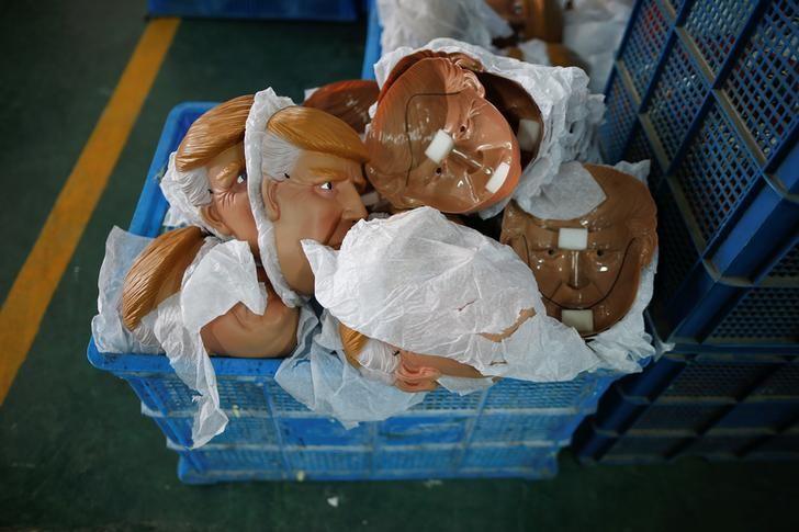 "Masks of U.S. Republican presidential candidate Donald Trump lie in a box at Jinhua Partytime Latex Art and Crafts Factory in Jinhua, Zhejiang Province, China, May 25, 2016. There's no masking the facts. One Chinese factory is expecting Donald Trump to beat his likely U.S. presidential rival Hilary Clinton in the popularity stakes. At the Jinhua Partytime Latex Art and Crafts Factory, a Halloween and party supply business that produces thousands of rubber and plastic masks of everyone from Osama Bin Laden to Spiderman, masks of Donald Trump and Democratic frontrunner Hillary Clinton faces are being churned out. Sales of the two expected presidential candidates are at about half a million each but the factory management believes Trump will eventually run out the winner. ""Even though the sales are more or less the same, I think in 2016 this mask will completely sell out,"" said factory manager Jacky Chen, indicating a Trump mask. REUTERS/Aly Song"