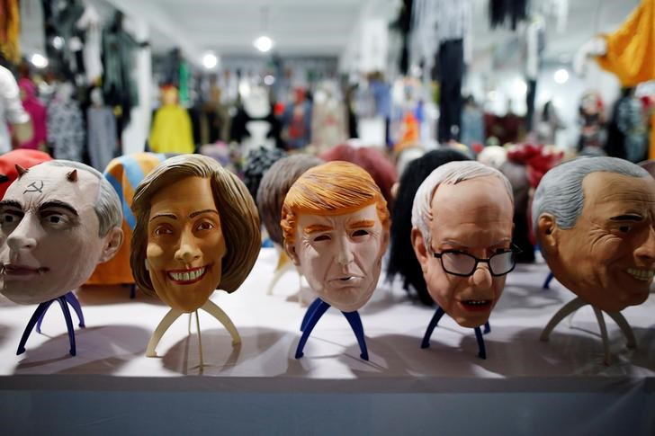 Masks of different politicians are displayed in the showroom of Jinhua Partytime Latex Art and Crafts Factory in Jinhua, Zhejiang Province, China, May 25, 2016. REUTERS/Aly Song