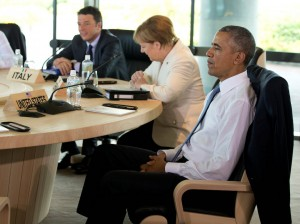U.S. President Barack Obama, right, Italian Prime Minister Matteo Renzi, left, and German Chancellor Angela Merkel participate in a G-7 Working Session in Shima, Japan, Friday, May 27, 2016, during the G-7 Summit. REUTERS/Carolyn Kaster/Pool