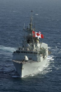 HMCS Toronto flies a Canadian flag in the Arabian Gulf during Operation Altair with the US Navy, a 2004 mission to monitor shipping in the Arabian Gulf. Photo by MCpl Colin Kelley, Canadian Armed Forces