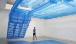 A visitor looks at an installation by Do Ho Suh + Suh architects during the Architecture Biennale Exhibition in Venice August 31, 2010. REUTERS/Tony Gentile (ITALY - Tags: SOCIETY) - RTR2HR1K