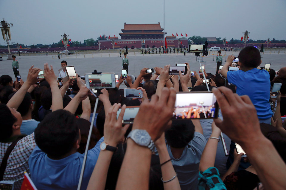 People film with their phones and cameras during a flag-raising ceremony at the Tiananmen Square in Beijing, China June 4, 2016.   REUTERS/Damir Sagolj.