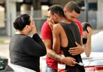 After Orlando shooting friends and family members embrace outside the Orlando Police Headquarters during the investigation of a shooting at the Pulse night club,in Orlando, Florida, June 12, 2016. REUTERS/Steve Nesius