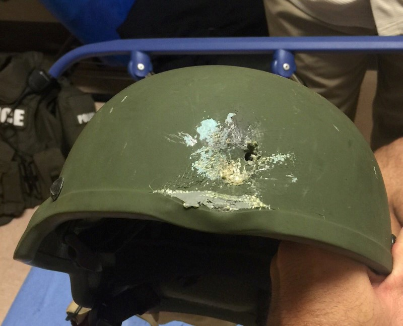 "A handout photograph posted by the Orlando Police Department on Twitter with the words, ""Pulse shooting: In hail of gunfire in which suspect was killed, OPD officer was hit. Kevlar helmet saved his life"", in reference to the operation against a gun man inside Pulse night club in Orlando, Florida, June 12, 2016. Orlando Police Department/Handout via REUTERS"