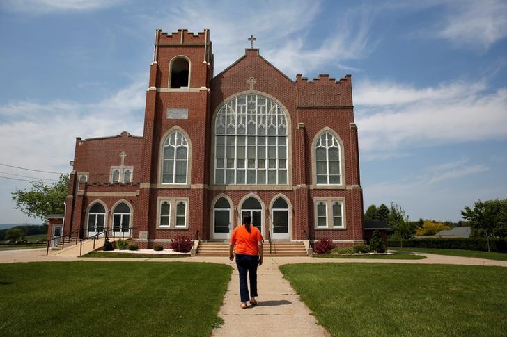 Kate Lynn Blatt, a transgender woman, walks up to Salem Belleman's Church in Mohrsville, Pennsylvania, United States, May 25, 2016.  REUTERS/Shannon Stapleton