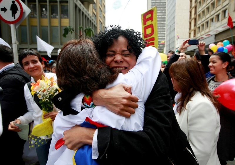 Women hug as they celebrate the signing of a historic ceasefire deal between the Colombian government and FARC rebels in Bogota, Colombia, June 23, 2016. REUTERS/John Vizcaino